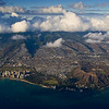 Just after departure from Honolulu International, Diamond Head and Waikiki Beach on bustling, overcrowded Oahu.